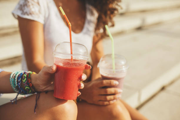fresh fruit smoothie - drinking juice stock photos and pictures