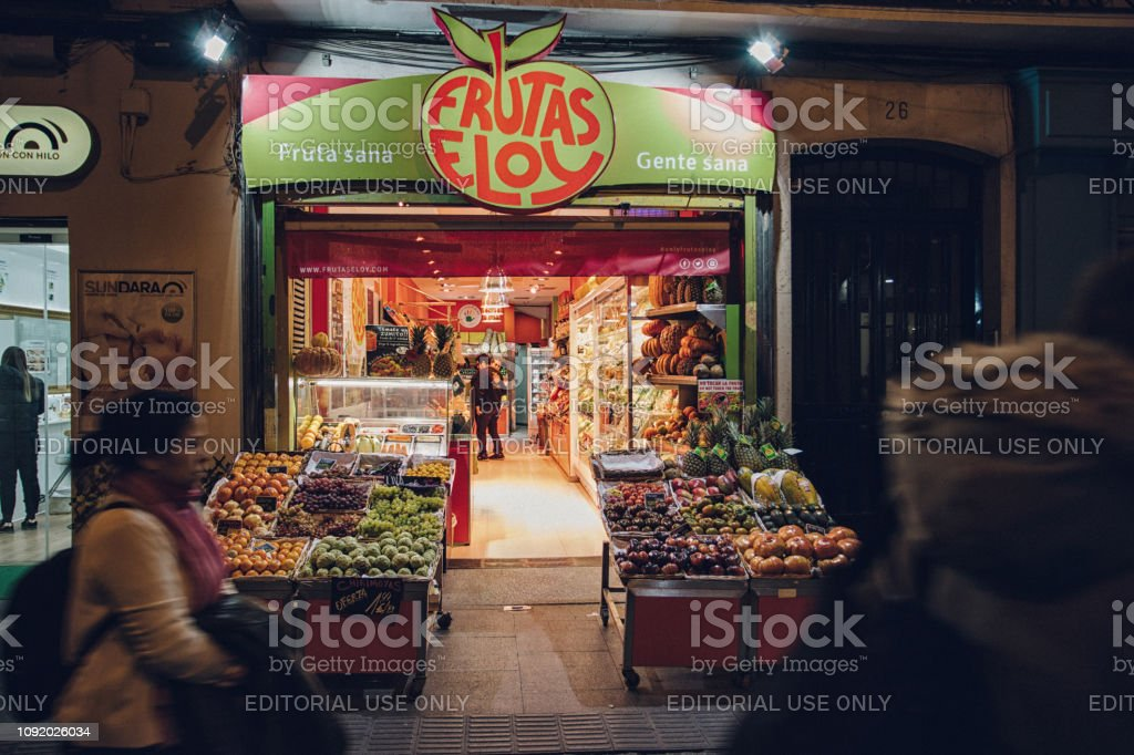 fresh fruit stand and store front stock photo