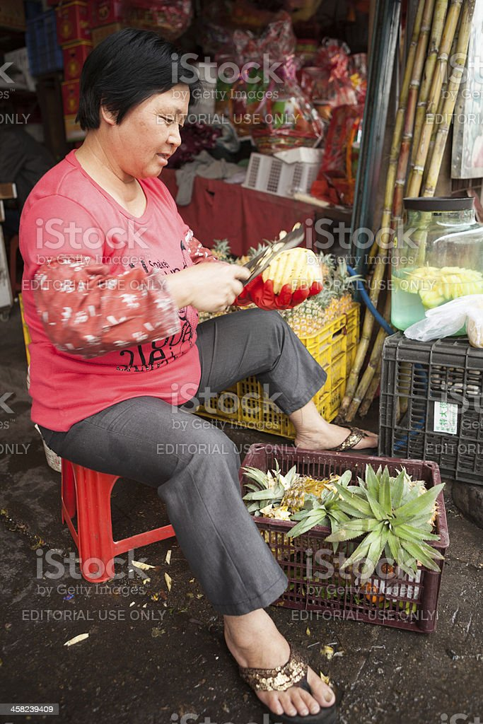Fresh fruit stand sells pineapples in China stock photo