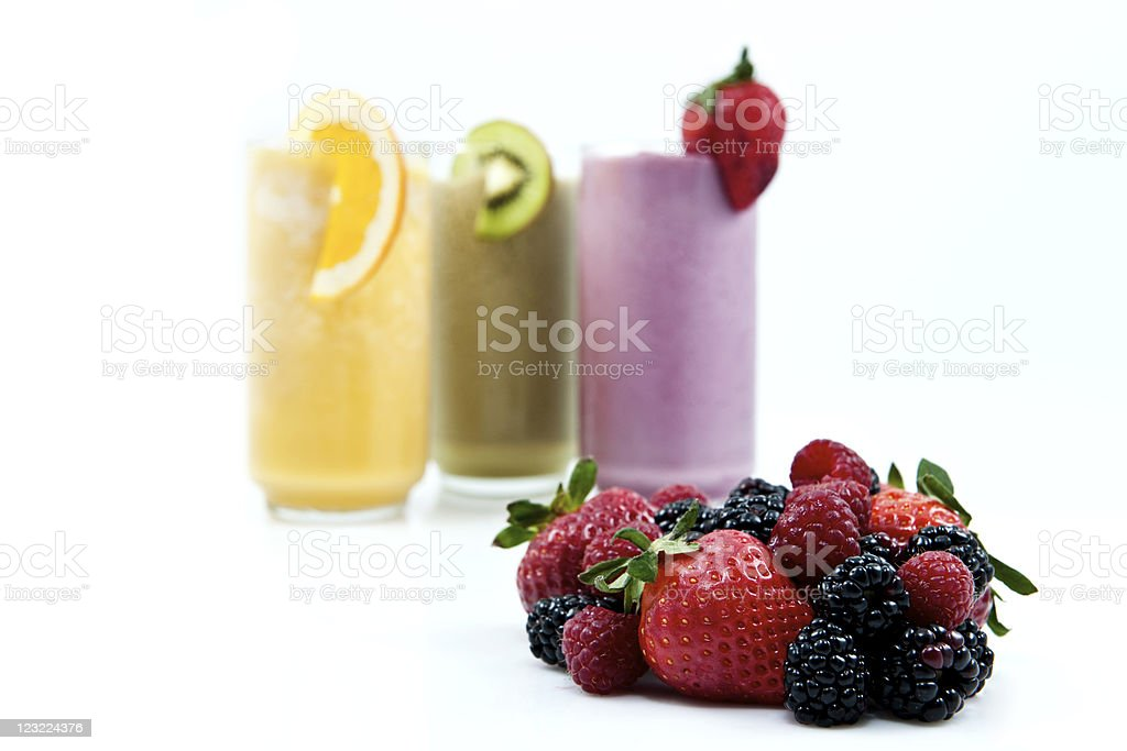 Fresh fruit with smoothies in the background stock photo