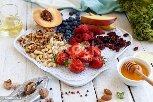 854725402 istock photo Fresh fruits and berries with nuts 1139866894