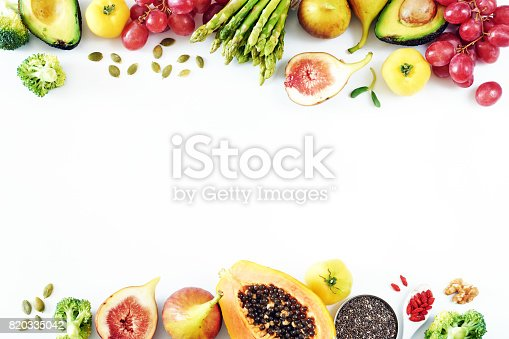 istock Fresh fruits and vegetables food frame over white background with empty space. 820335042