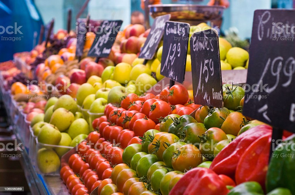Fresh fruits and vegetables in display at market stock photo