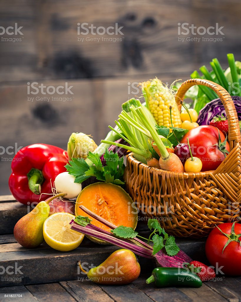 Fresh fruits and vegetables in the basket stock photo
