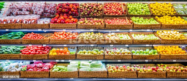 istock Fresh fruits and vegetables on shelf in market 908168476