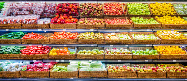 fresh fruits and vegetables on shelf in market - verdura cibo foto e immagini stock