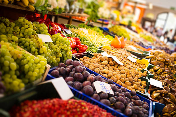 fresh fruits and vegetables fresh fruits and  vegetables at a market hall market hall stock pictures, royalty-free photos & images