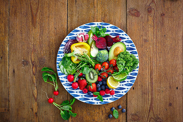 fresh fruits and vegetables salad - portion bildbanksfoton och bilder