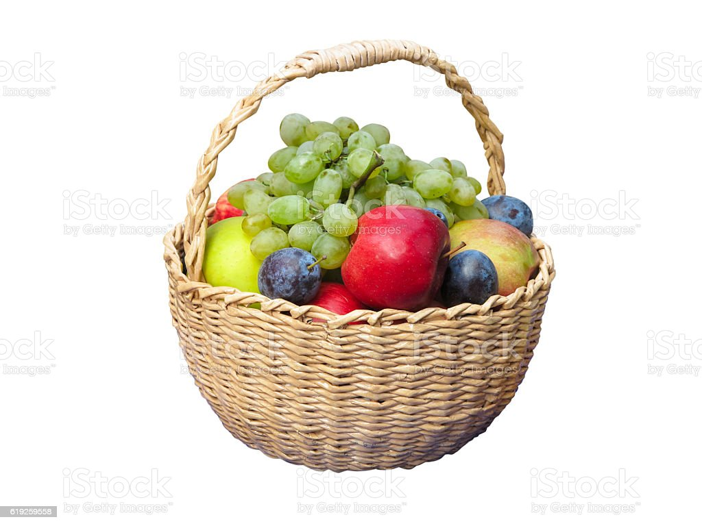 Fresh fruits arranged in a wicker basket isolated on white stock photo