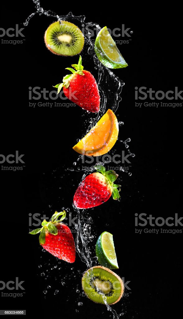 Fresh fruits falling in water splash foto de stock royalty-free