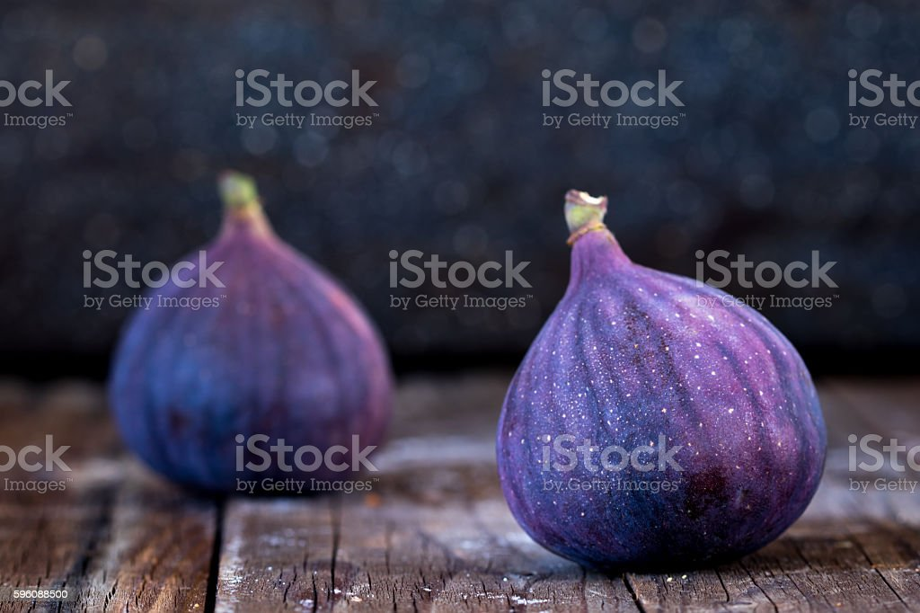 Fresh fruits, figs on an old wooden table. royalty-free stock photo