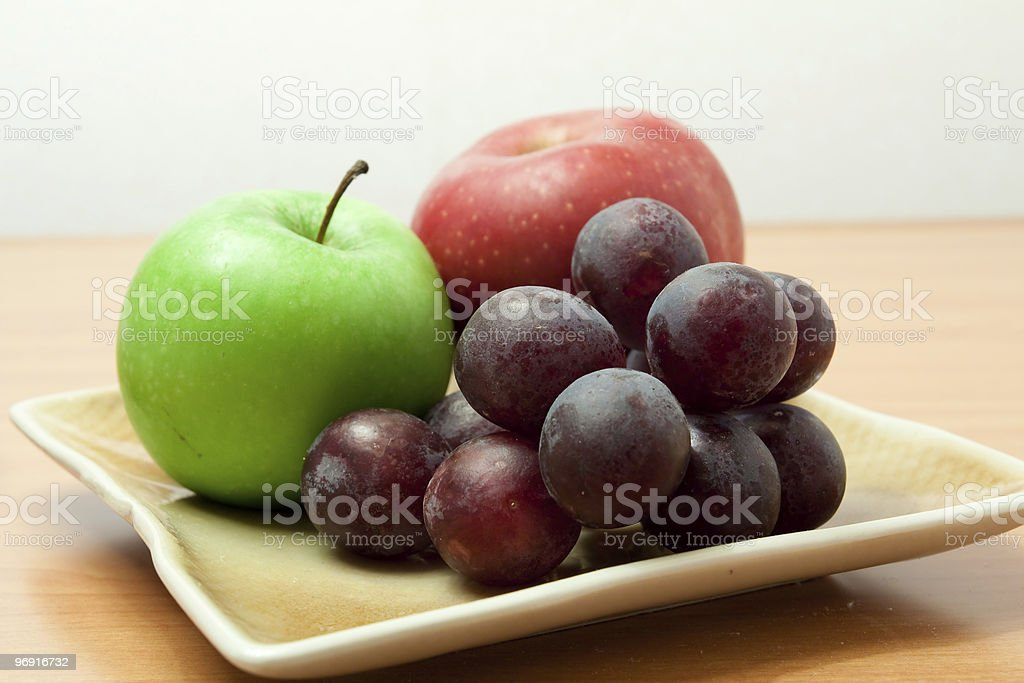 Fresh fruits in a plate royalty-free stock photo