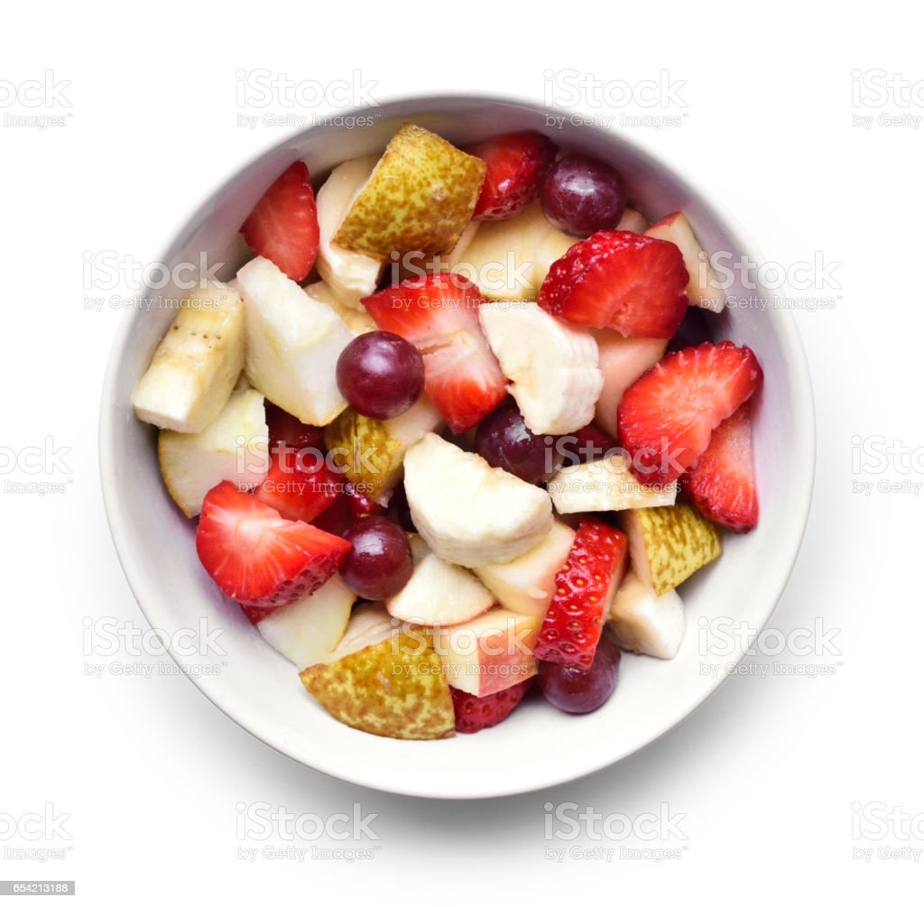 Fresh fruits in a white bowl stock photo