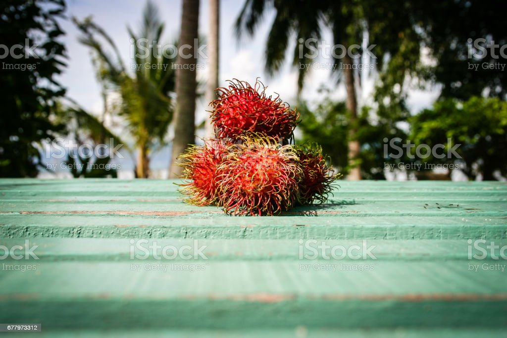 Fresh fruits on the table. Close to the beach. Good breakfast at the morning. royalty-free stock photo