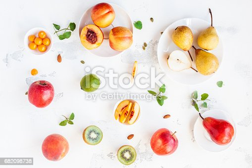 istock Fresh fruits on white background. Flat lay, top view 682098738