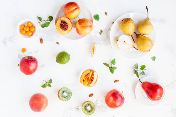 Fresh fruits on white background. Flat lay, top view stock photo