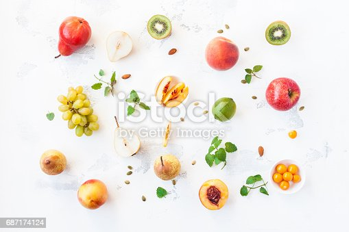 istock Fresh fruits on white background. Flat lay, top view 687174124
