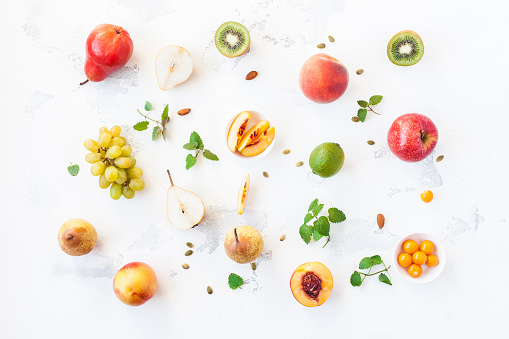 Fresh fruits on white background. Flat lay, top view
