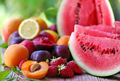 istock fresh fruits on wooden table 501706215