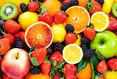 Fresh fruits background.Colorful organic fruits background.