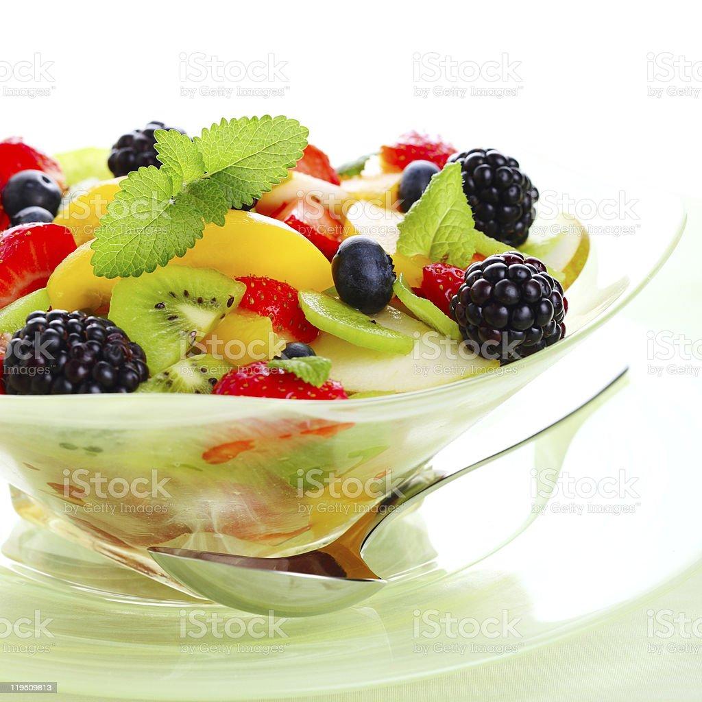 Fresh fruits salad on white background royalty-free stock photo