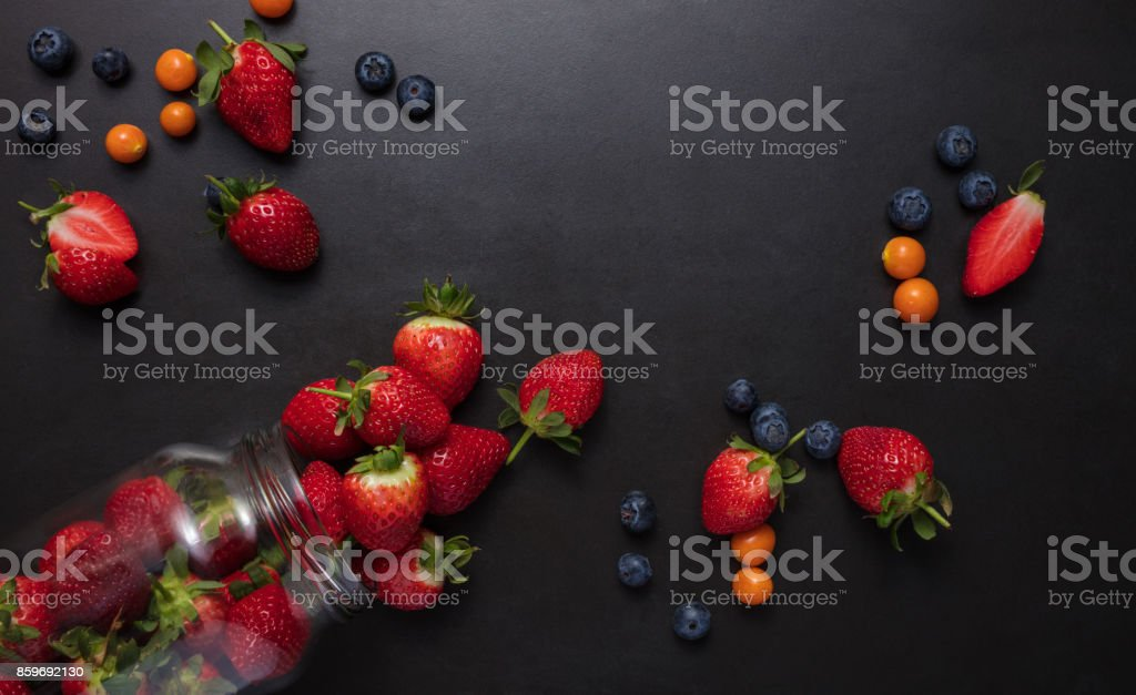 Fresh fruits scattered on table stock photo
