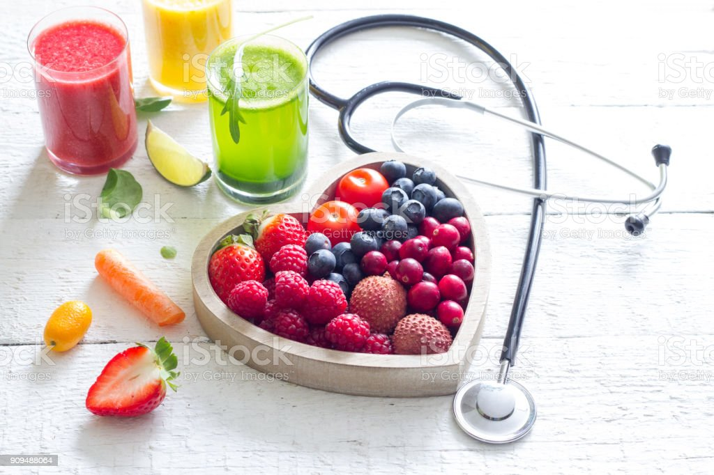 Fresh fruits vegetables and heart shape with stethoscope health diet concept stock photo