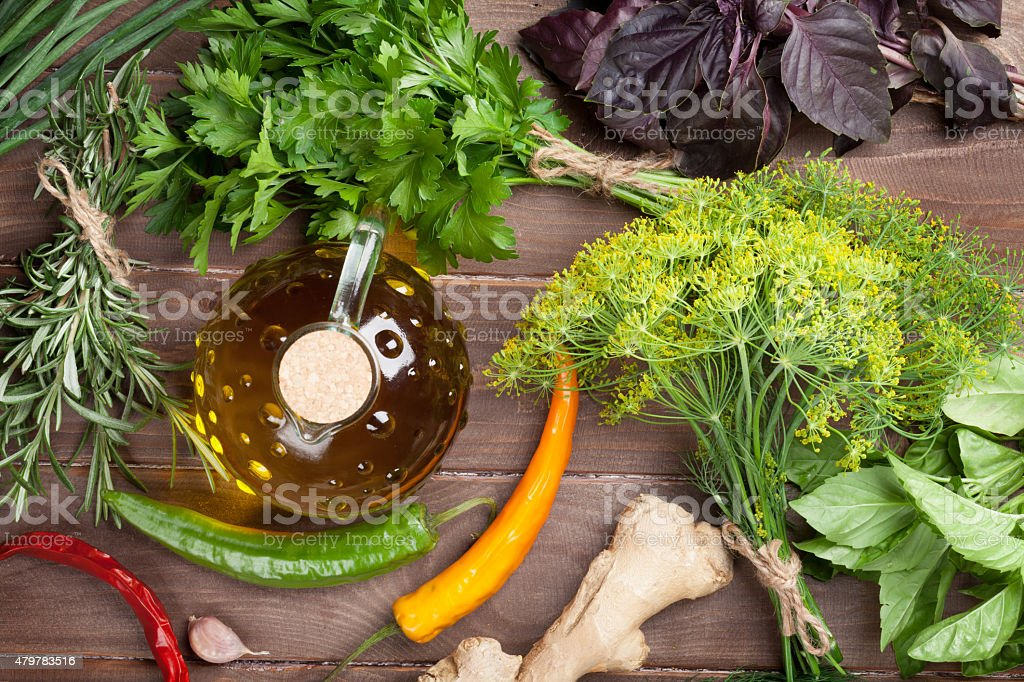 Fresh garden herbs and olive oil stock photo