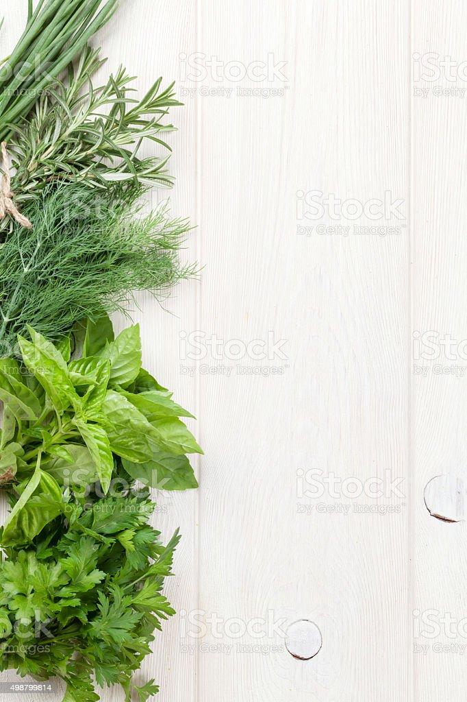 Fresh garden herbs on wooden table stock photo