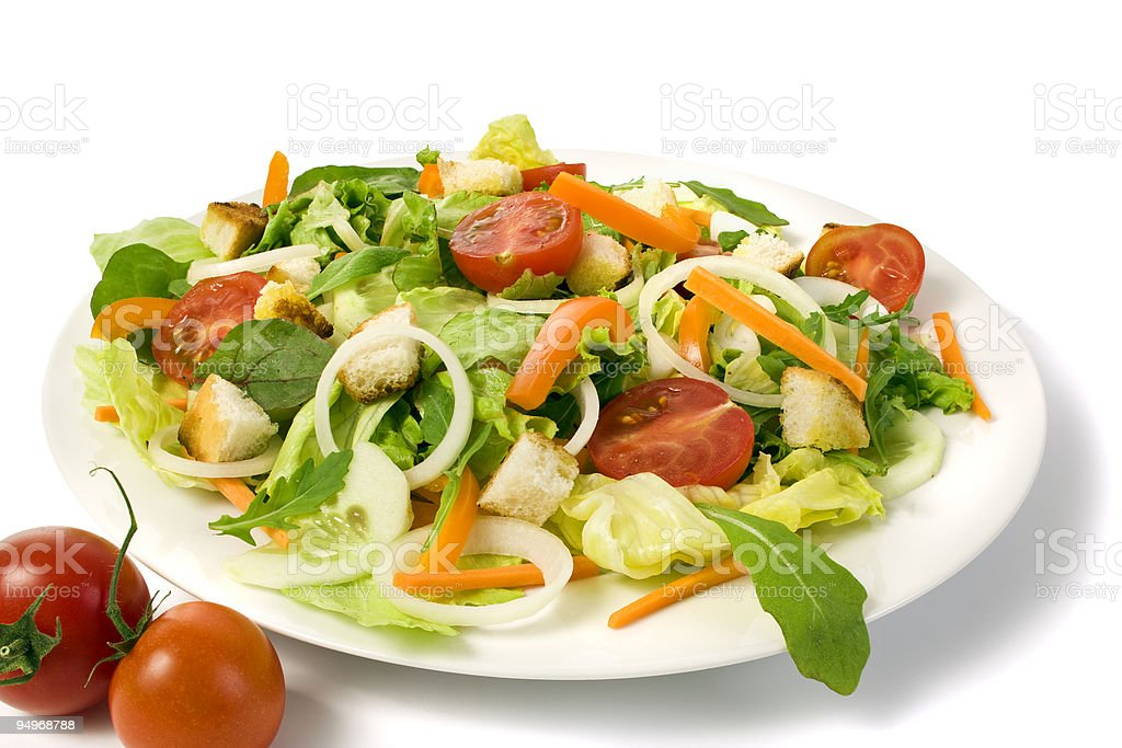 fresh garden salad on a plate isolated stock photo