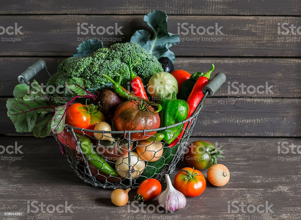 Fresh garden vegetables in vintage metal basket stock photo