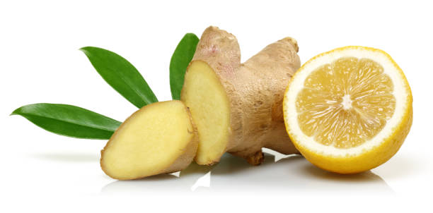 Fresh ginger and lemon with leaves isolated on white background Fresh ginger and lemon with leaves isolated on white background ginger spice stock pictures, royalty-free photos & images