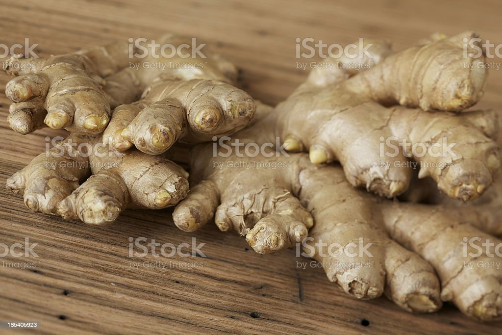 Fresh ginger root on rustic wood table royalty-free stock photo