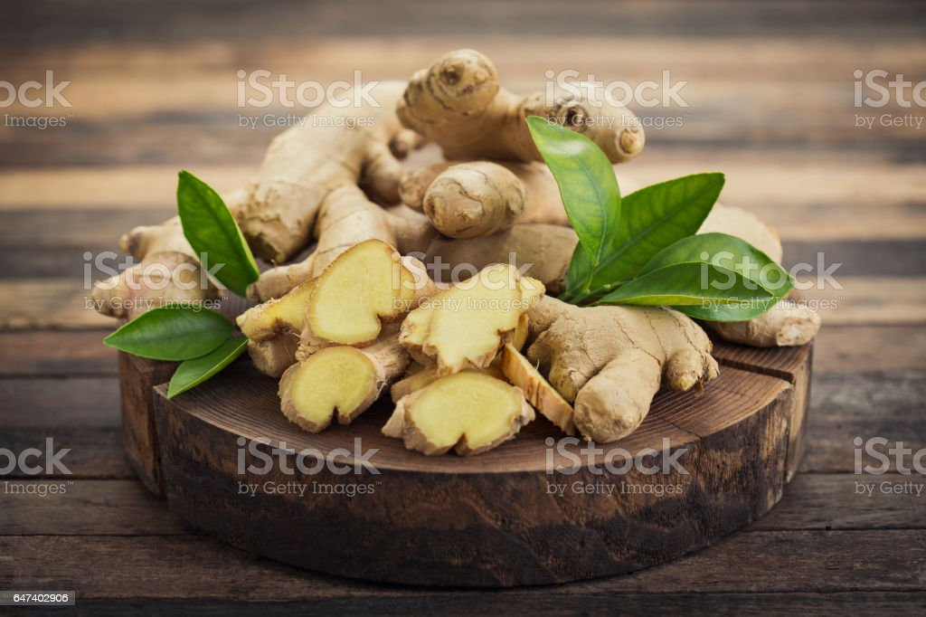 Fresh ginger root on the wooden table stock photo