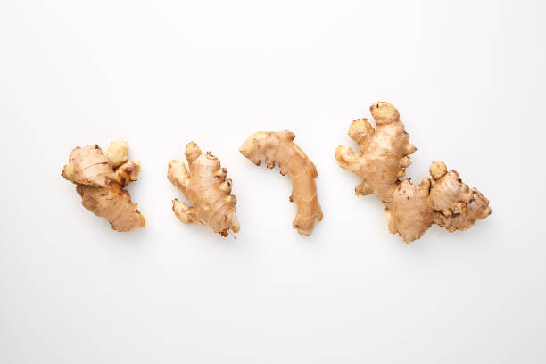 Cтоковое фото Fresh Ginger root on white background
