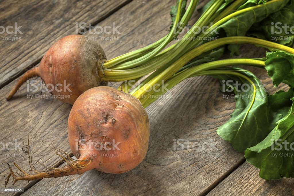 Fresh golden beetroot on a timber table stock photo