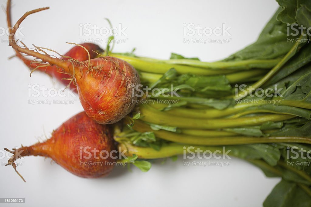 Fresh golden beets with greens attached stock photo