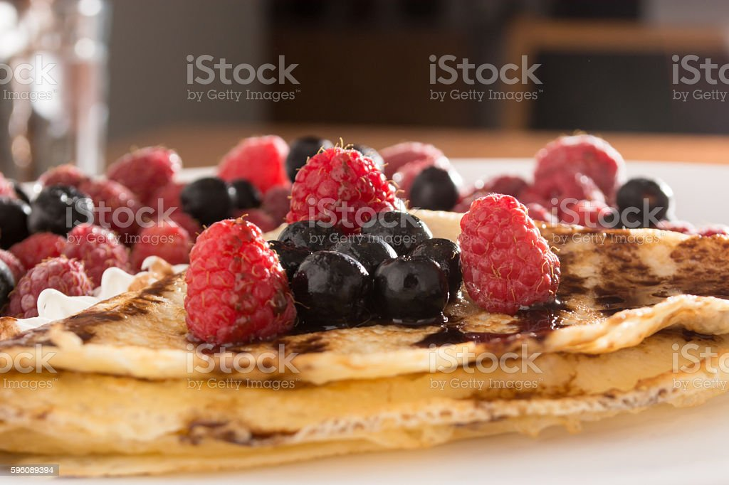 Fresh, golden pancakes with fruit and cream royalty-free stock photo