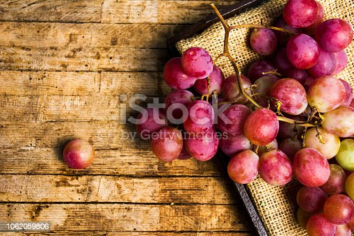 Fresh grape on a rustic wooden background, fresh fruit