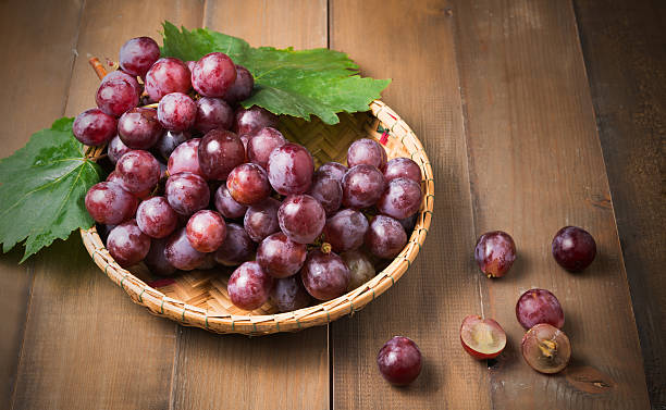 fresh grape on bamboo basket. stock photo
