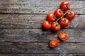 Fresh grape tomatoes with coarse salt, top view with copy space