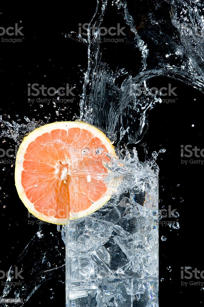 Fresh grapefruit and water royalty-free stock photo