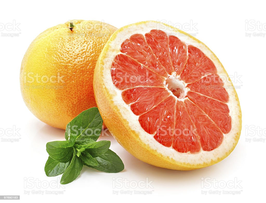 fresh grapefruit with cut isolated royalty-free stock photo