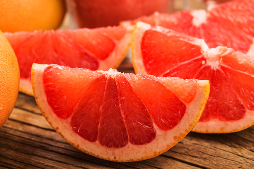 Fresh grapefruits on wooden background with copyspace