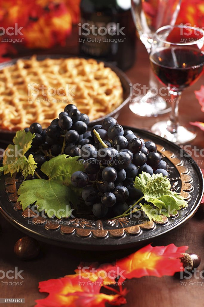 Fresh grapes and glass of wine stock photo