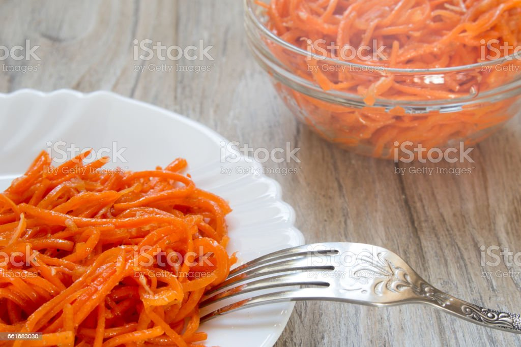 Fresh grated carrots with spices Korean, close up stock photo