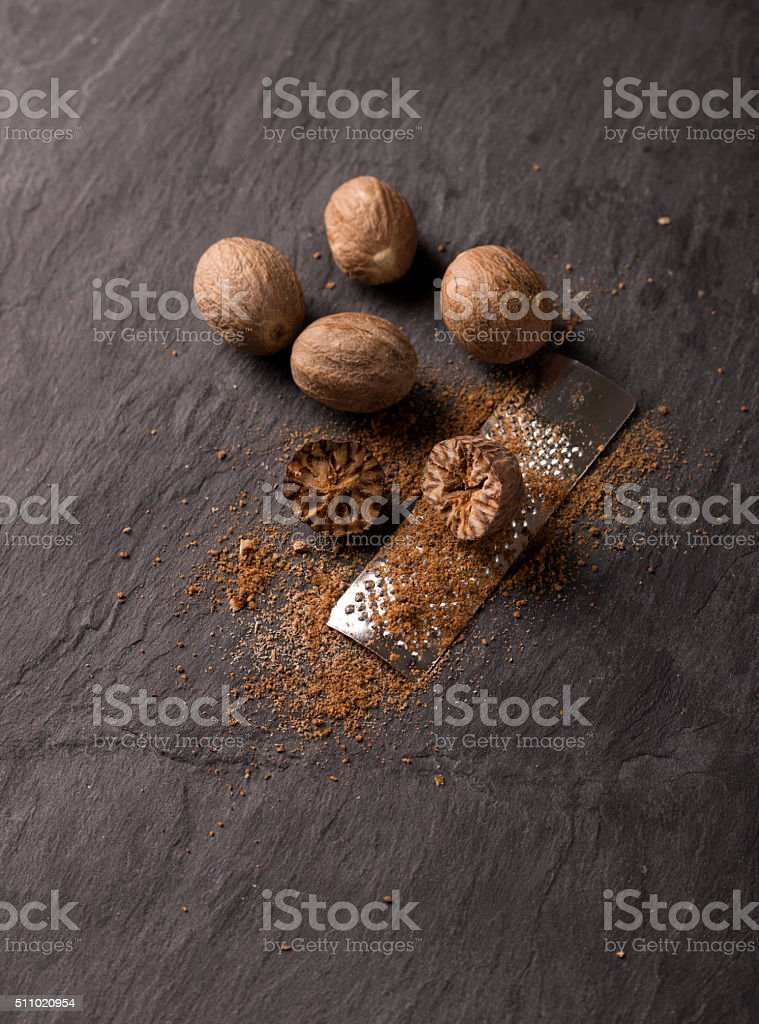 fresh grated nutmeg stock photo