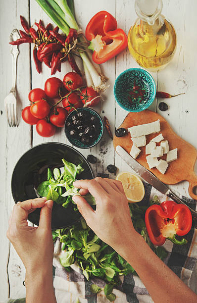 fresh greek salad cooking process - onion juice stock photos and pictures