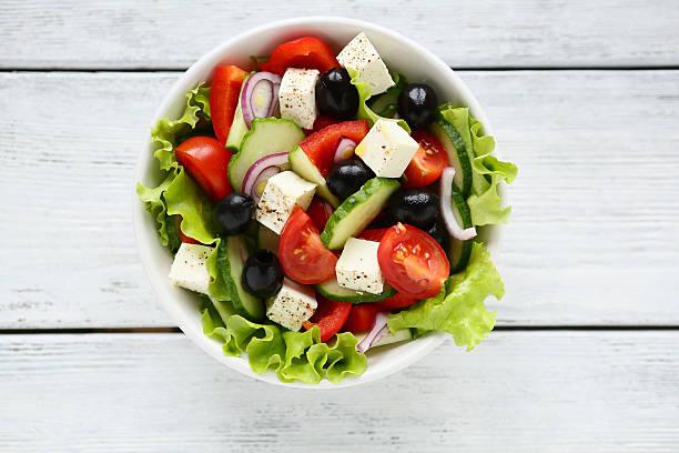 Fresh Greek salad in a bowl stock photo