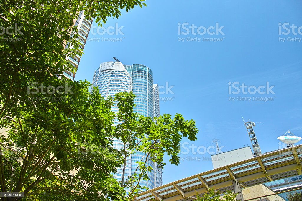 Fresh green and high-rise buildings stock photo